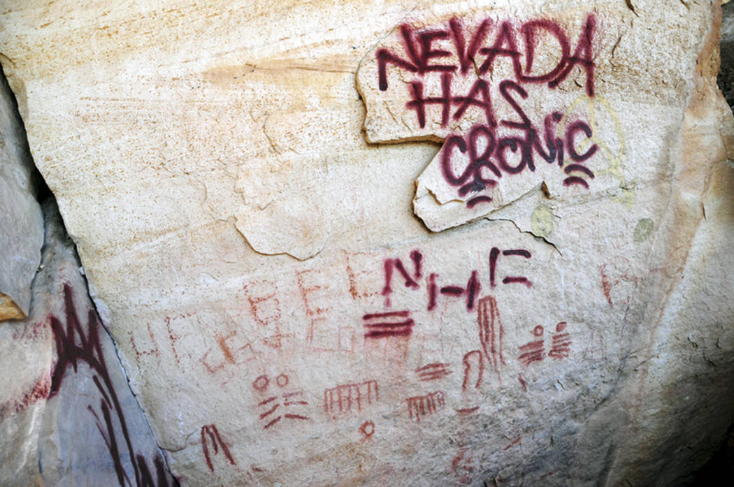 Maroon graffiti defaces stone in the Red Rock Canyon National Conservation Area in November 2010. A tagger gang allegedly vandalized the site painting rocks and in some cases painting on or near a ...