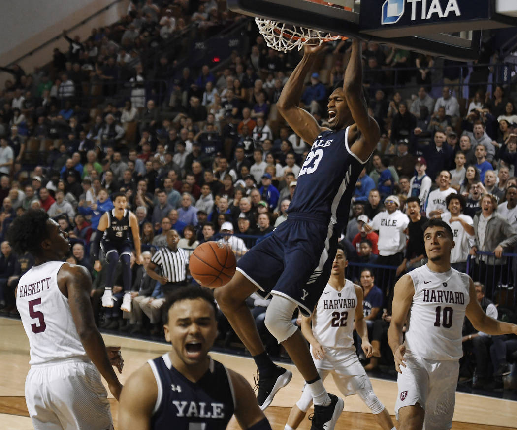 Yale's Jordan Bruner dunks the ball during the second half of an NCAA college basketball game for the Ivy League championship against Harvard at Yale University in New Haven, Conn., Sunday, March ...