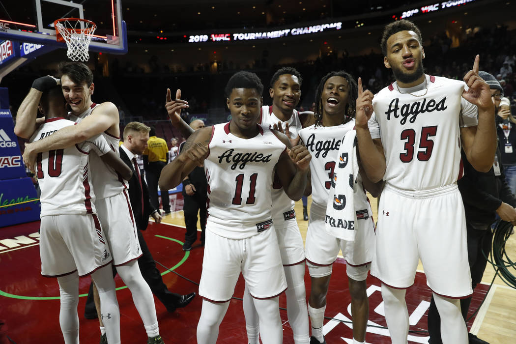 New Mexico State players celebrate after an 89-57 win over Grand Canyon in an NCAA college basketball game for the Western Athletic Conference men's tournament championship Saturday, March 16, 201 ...