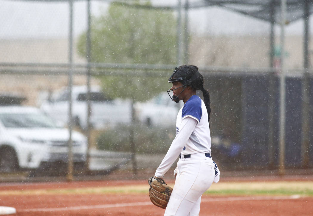 Shadow Ridge's Jasmine Martin (8) gets ready to pitch in the first inning of a softball game as rain pours down at Shadow Ridge High School in Las Vegas on Wednesday, March 20, 2019. (Chase Steven ...