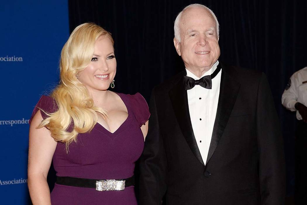 """In this May 3, 2014 file photo, Meghan McCain, and Sen. John McCain attend the White House Correspondents' Association Dinner in Washington. Meghan McCain says President Donald Trump life is """"pa ..."""