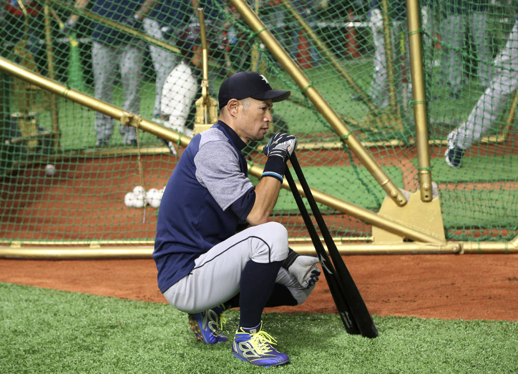 Seattle Mariners right fielder Ichiro Suzuki waits for batting prior to Game 1 of a Major League opening series baseball game against the Oakland Athletics at Tokyo Dome in Tokyo, Wednesday, March ...