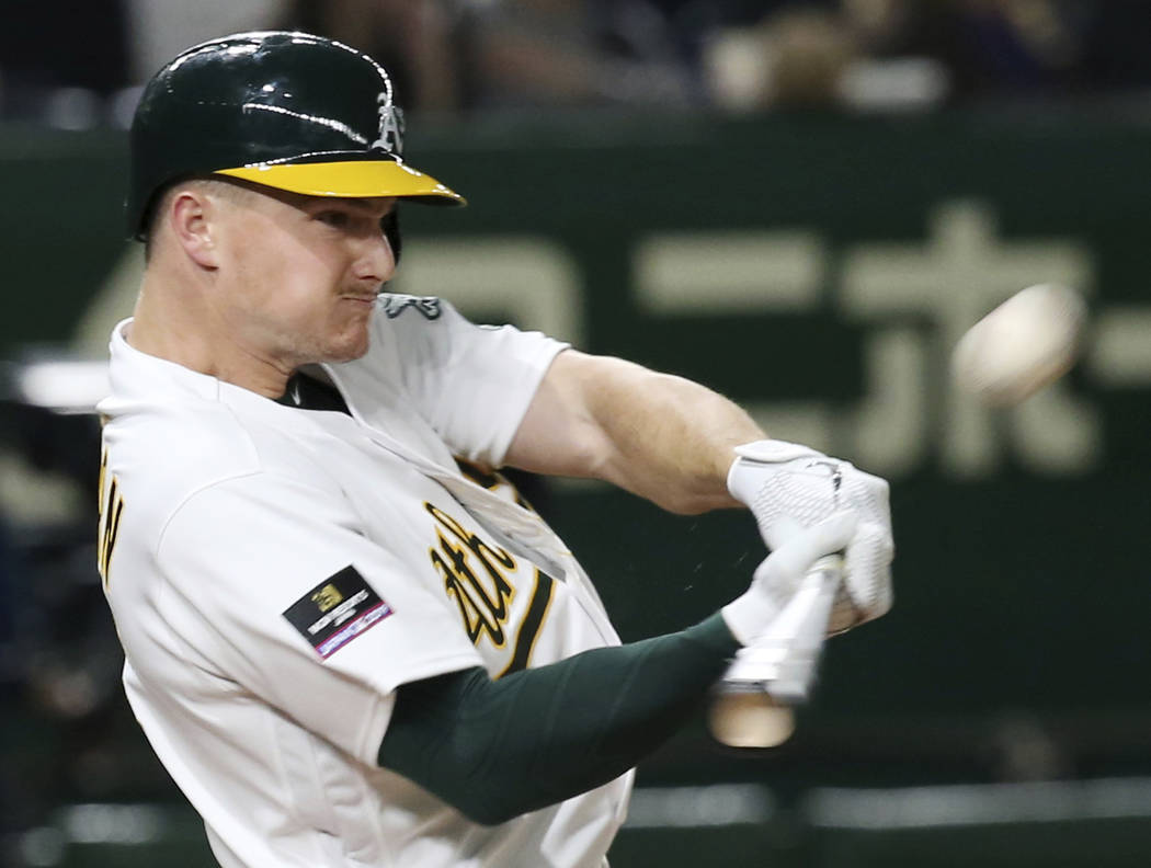Oakland Athletics's Matt Chapman hits a three-run home run off Seattle Mariners pitcher Nick Rumbelow in the seventh inning of Game 1 of their Major League opening series baseball game at Tokyo Do ...