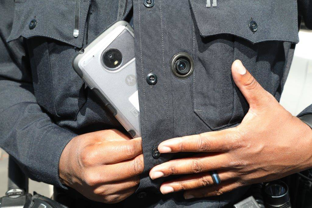 Henderson officer E. Duncan mounts his body-worn camera into place on his uniform. The cameras are part of a newly integrated system required by Senate Bill 176, which went into effect on Sunday, ...
