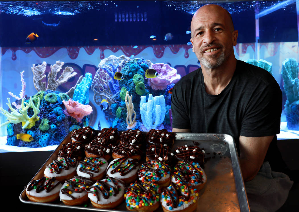 "Brett Raymer, a star of the TV show ""Tanked"" and a partner in Donut Mania, poses for a photo at his shop in Las Vegas on Friday, March 9, 2018. (Las Vegas Review-Journal)"
