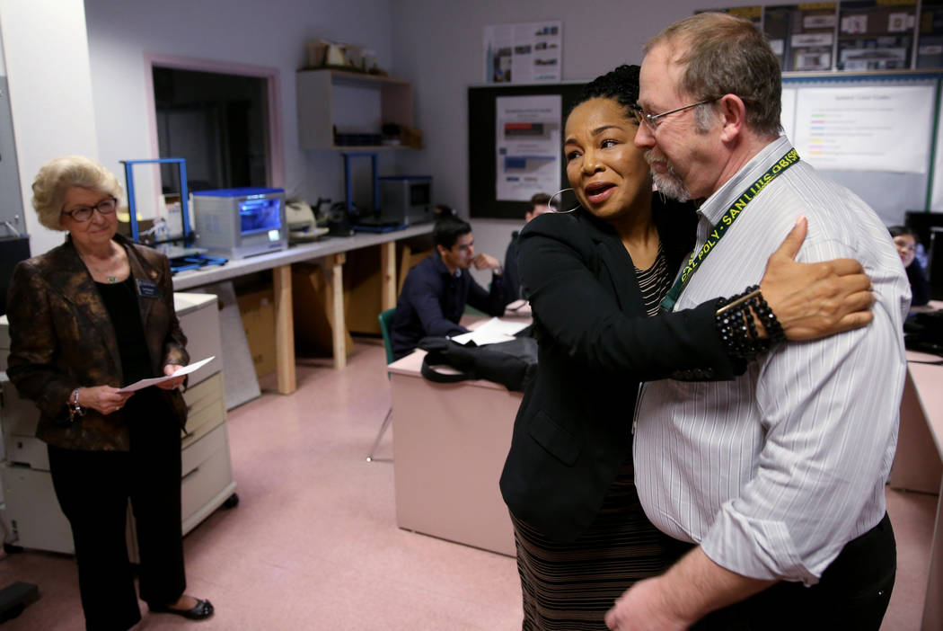 Advanced Technologies Academy teacher Richard Knoeppel, the Nevada Teacher of the Year, gets a hug from Nevada State Board of Education member Tonia Holmes-Sutton as he is told that he will be ind ...