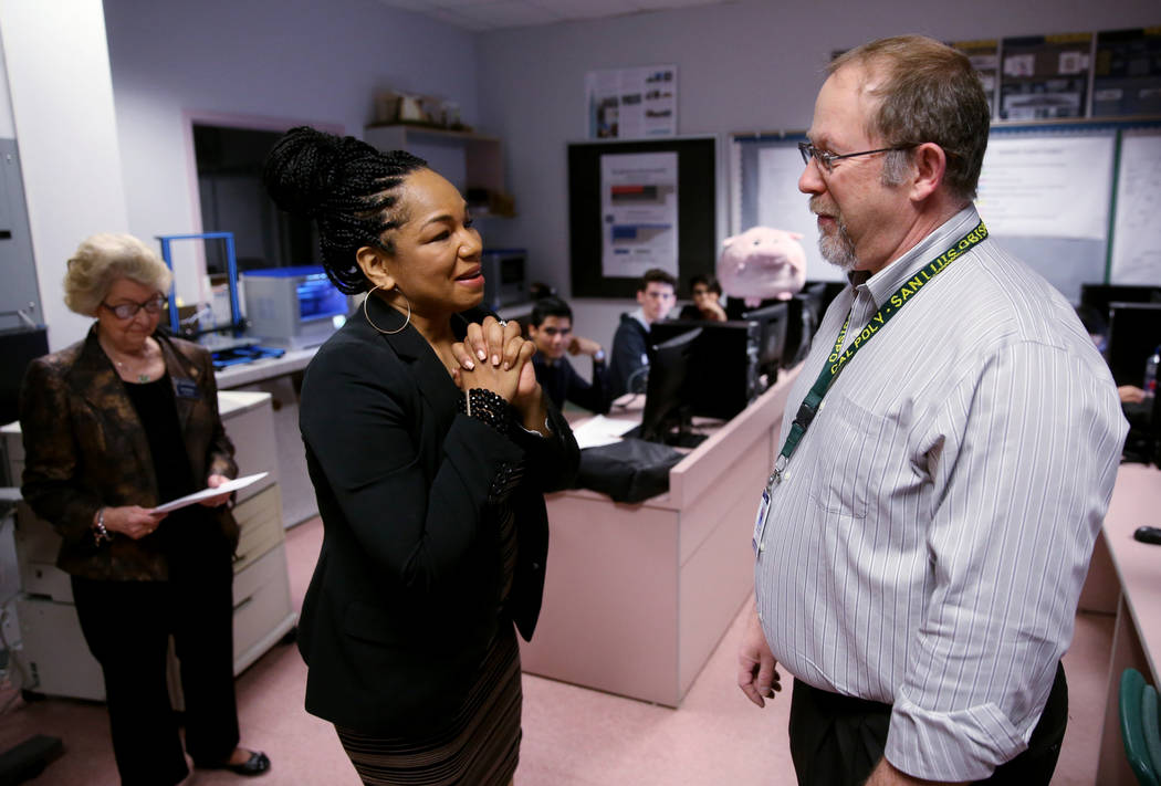 Advanced Technologies Academy teacher Richard Knoeppel, the Nevada Teacher of the Year, is congratulated by Nevada State Board of Education member Tonia Holmes-Sutton as he is told that he will be ...