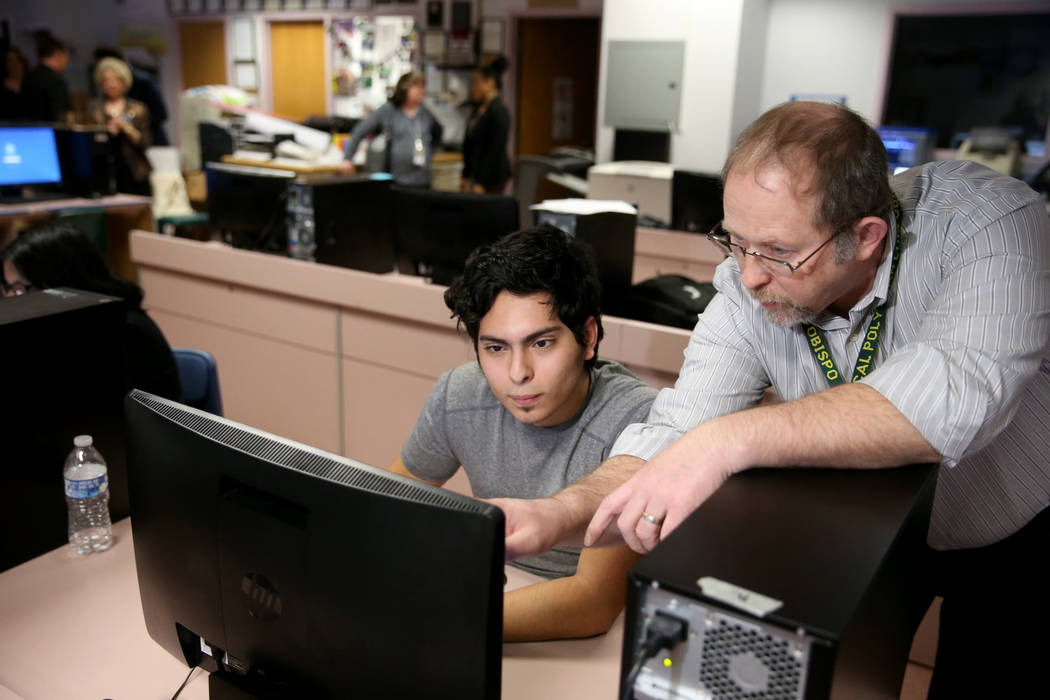 Advanced Technologies Academy teacher Richard Knoeppel, the Nevada Teacher of the Year, works with senior Edin Sosa at his Las Vegas school Wednesday, March 20, 2019. (K.M. Cannon/Las Vegas Review ...