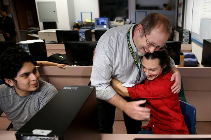 Advanced Technologies Academy teacher Richard Knoeppel, the Nevada Teacher of the Year, gets a hug from senior Isaac Carpenter after being told that he will be inducted into the National Teacher H ...