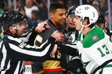 Golden Knights right wing Ryan Reaves (75) exchanges words with Dallas Stars center Mattias Janmark (13) during the second period of an NHL hockey game at T-Mobile Arena in Las Vegas on Tuesday, F ...