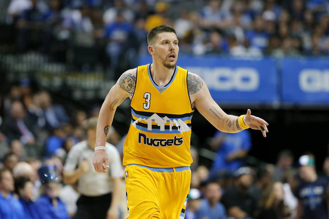 Denver Nuggets guard Mike Miller talks to an official was he jogs up court during an NBA basketball game against the Dallas Mavericks in Dallas, Tuesday, April 11, 2017. (AP Photo/Tony Gutierrez)