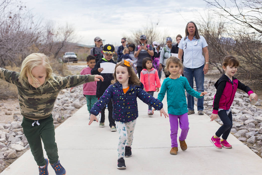 Declan Kriebel, 4, from left, Isabella LaMon, 3, Emma Campagna, 5, and Alina Velaochaga, 4, pretend to be owls during the Nature Tykes program at Clark County Wetlands Park in Las Vegas, Wednesday ...