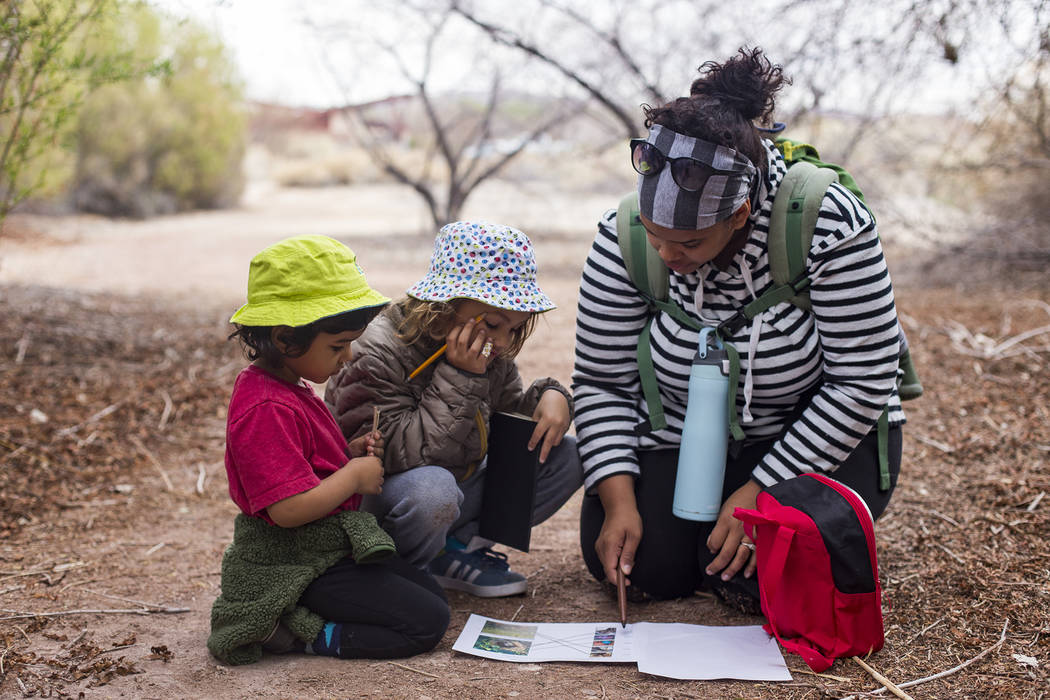 Jazzmine Schmidt works with her children Louie Schmidt, 3, left, and Boone Schmidt, 5, during an activity to learn about nests and birds during the Nature Tykes program at Clark County Wetlands Pa ...