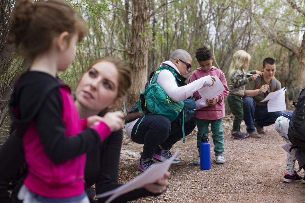 Lauryn Ricigliano helps her son Asante Ricigliano-Vaughn during an activity to learn about nests and birds during the Nature Tykes program at Clark County Wetlands Park in Las Vegas, Wednesday, Ma ...