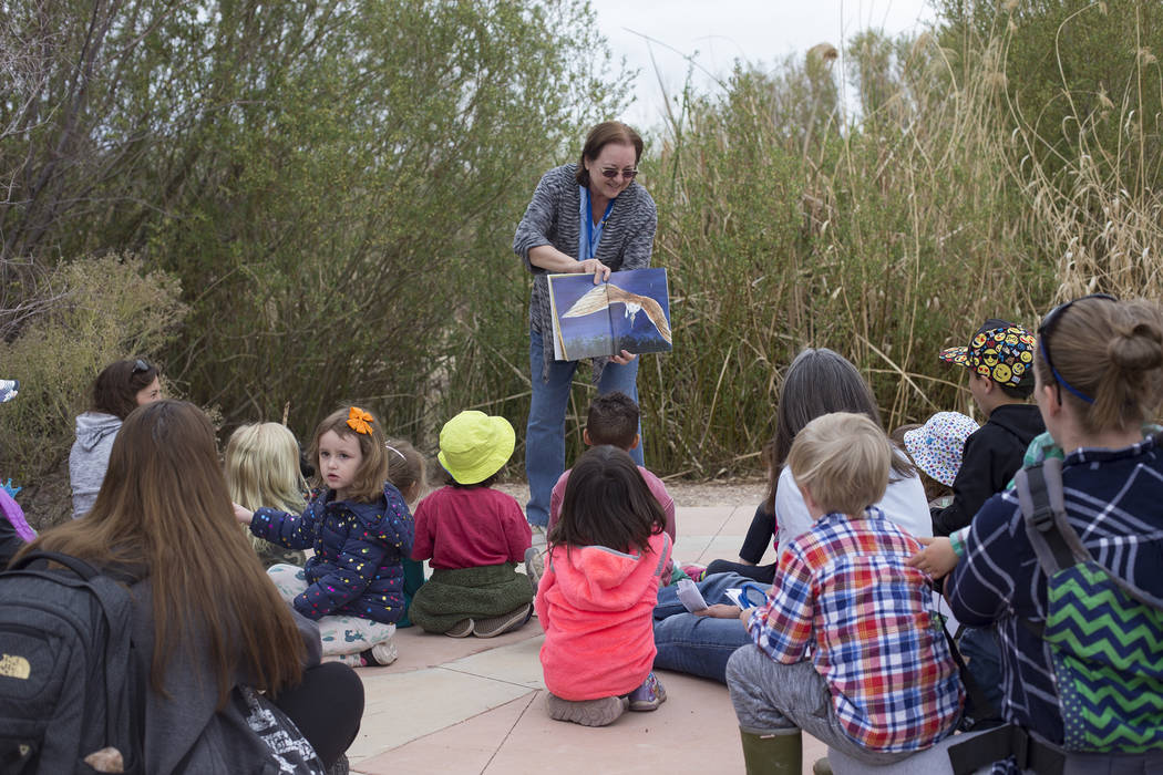 Volunteer Betty Monson reads a story to children during the Nature Tykes program at Clark County Wetlands Park in Las Vegas, Wednesday, March 20, 2019. The program incorporates story time, crafts, ...