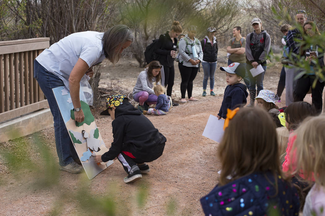 Naturalist Jody Walker helps Jesse Camacho, 7, put together a bird during the Nature Tykes program at Clark County Wetlands Park in Las Vegas, Wednesday, March 20, 2019. The program incorporates s ...