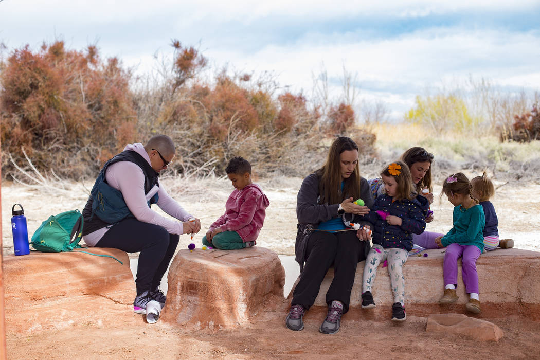 "Parents help their children create a ""bad mother"" bird during the Nature Tykes program at Clark County Wetlands Park in Las Vegas, Wednesday, March 20, 2019. The program incorporates sto ..."