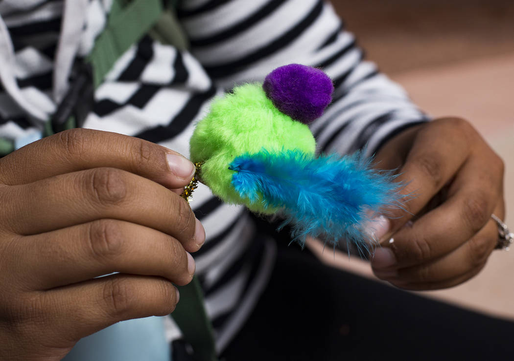 "Jazzmine Schimdt helps her kids create a ""bad mother"" bird during the Nature Tykes program at Clark County Wetlands Park in Las Vegas, Wednesday, March 20, 2019. The program incorporates ..."