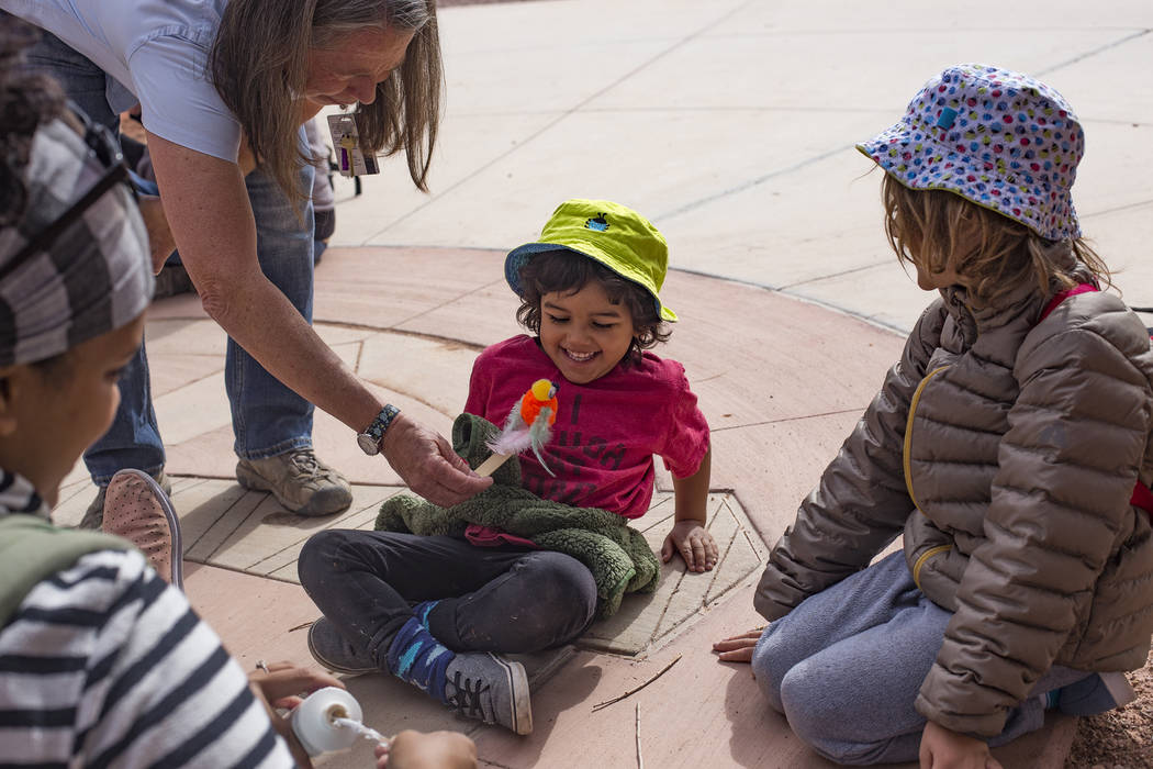 Naturalist Jody Walker teases Louie Schmidt, 3, with the craft they created during the Nature Tykes program at Clark County Wetlands Park in Las Vegas, Wednesday, March 20, 2019. The program incor ...