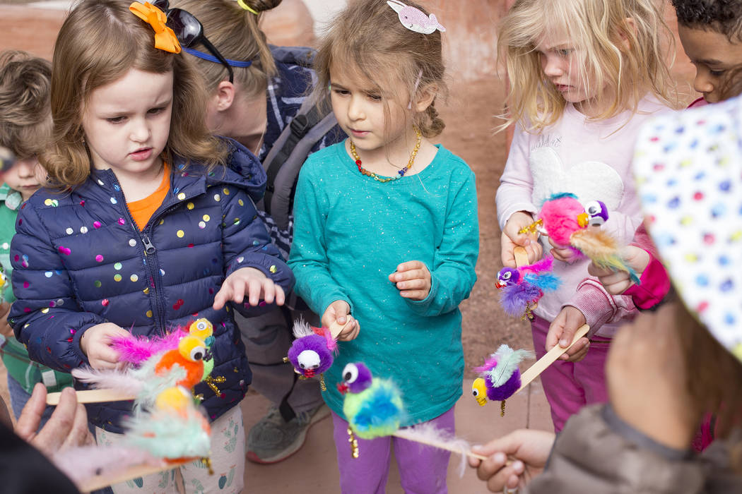 Isabella LaMon, 3, from left, Emma Campagna, 5, and Quinn Stanley, 3, hold the crafts they created during the Nature Tykes program at Clark County Wetlands Park in Las Vegas, Wednesday, March 20, ...