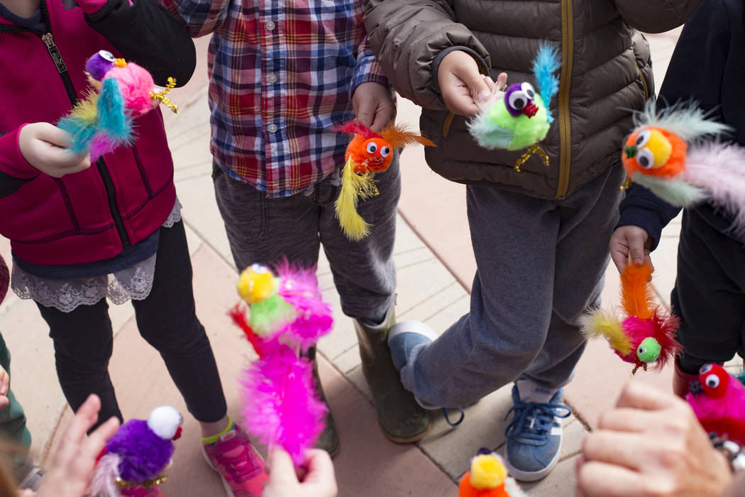 Children hold the crafts they created during the Nature Tykes program at Clark County Wetlands Park in Las Vegas, Wednesday, March 20, 2019. The program incorporates story time, crafts, and explor ...