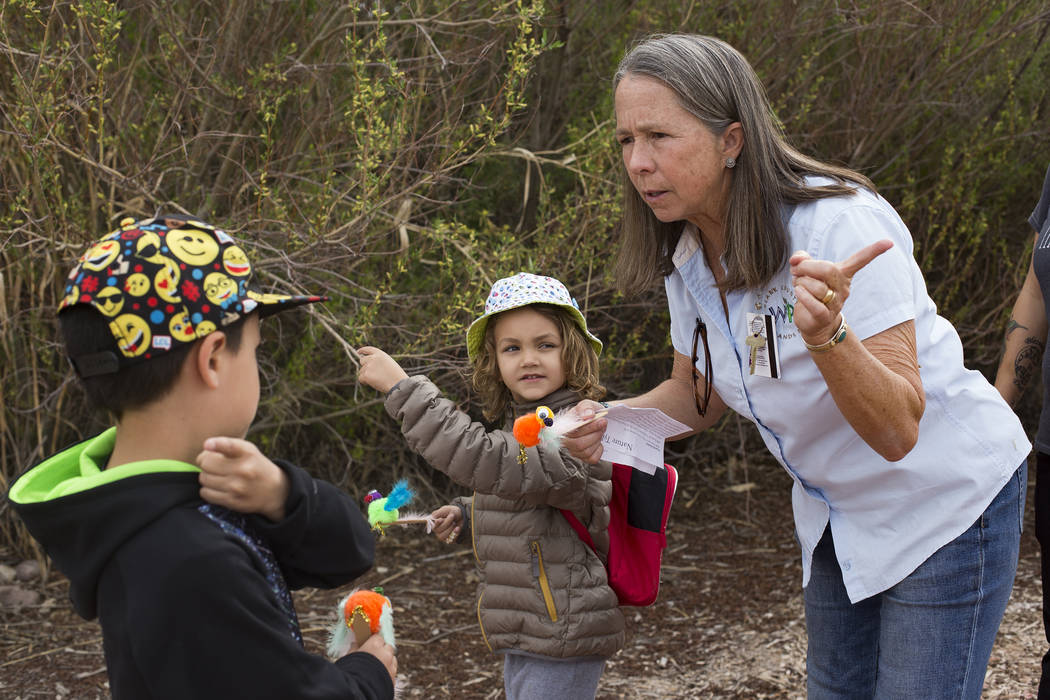 Naturalist Judy Walker speaks to Jesse Camacho, 7, next to Boone Schmidt, 5, during the Nature Tykes program at Clark County Wetlands Park in Las Vegas, Wednesday, March 20, 2019. The program inco ...