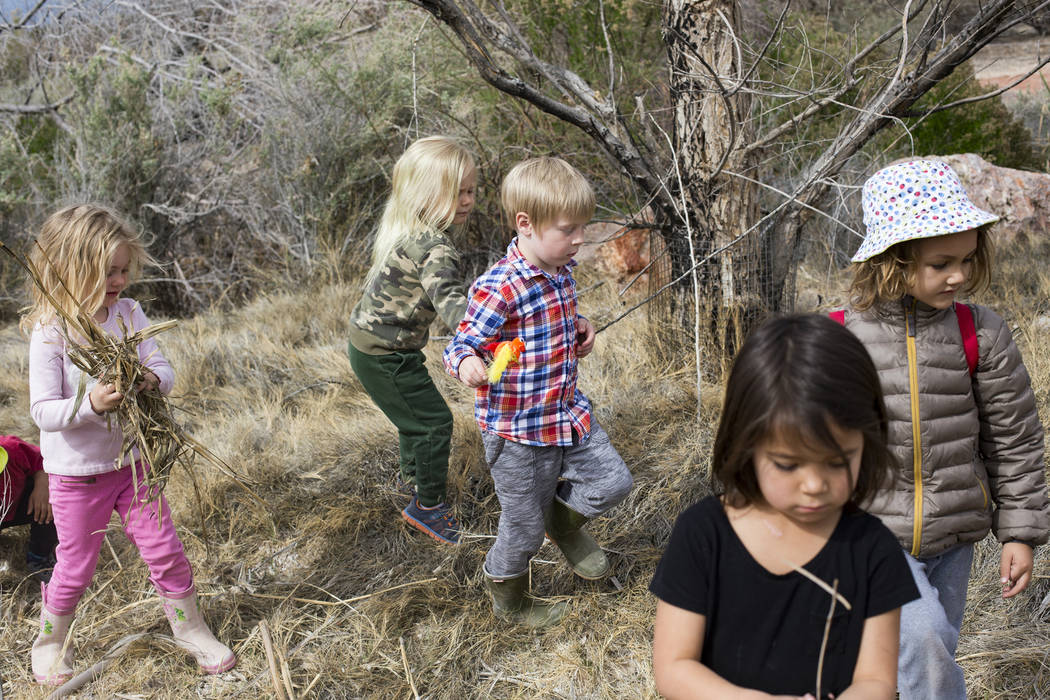 Children play freely during the Nature Tykes program at Clark County Wetlands Park in Las Vegas, Wednesday, March 20, 2019. The program incorporates story time, crafts, and exploration for kids th ...