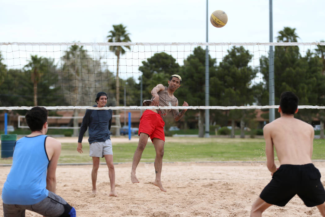 Eric Szukiewicz, from left, Shilo Chow, Blane Quitog, and Chansten Chow, play volleyball at Sunset Park in Las Vegas, Wednesday, March 20, 2019. Erik Verduzco Las Vegas Review-Journal @Erik_Verduzco