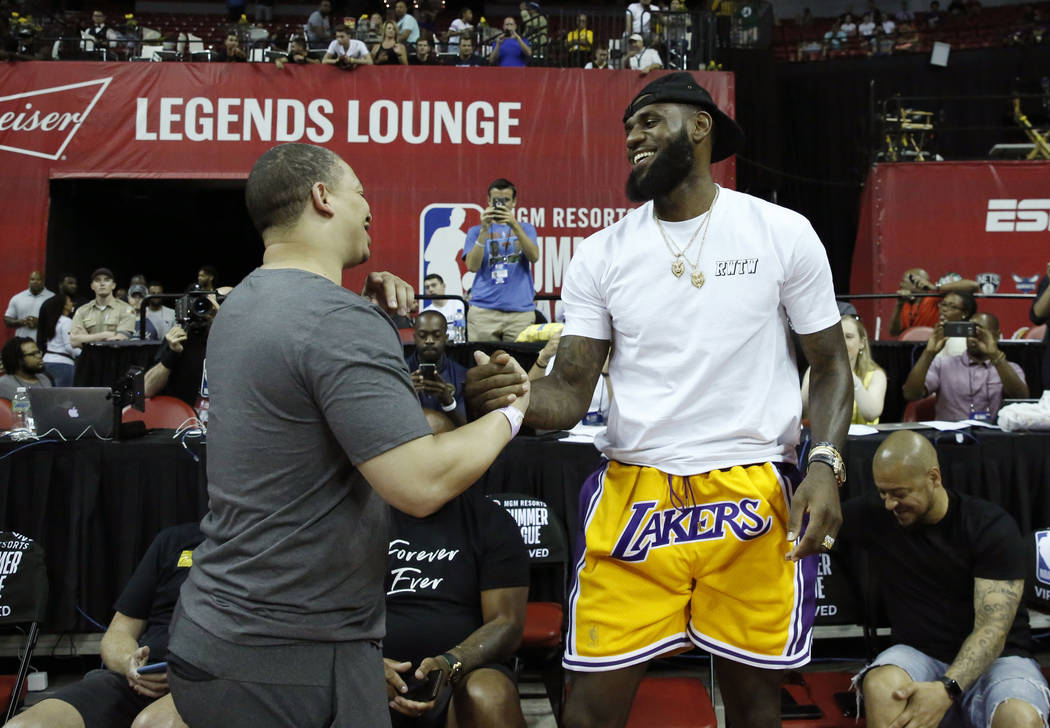 The Los Angeles Lakers LeBron James shakes hands with Cleveland Cavaliers coach Tyronn Lue at the Thomas and Mack Center during an NBA Summer League basketball game on Sunday, July 15, 2018, in L ...