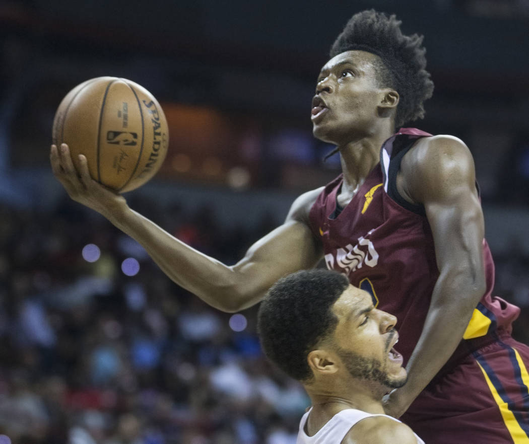 Cleveland Cavaliers guard Collin Sexton (2) drives past Los Angeles Lakers forward Jeff Ayres (12) in the second quarter during the NBA Summer League semifinals on Monday, July 16, 2018, at the Th ...