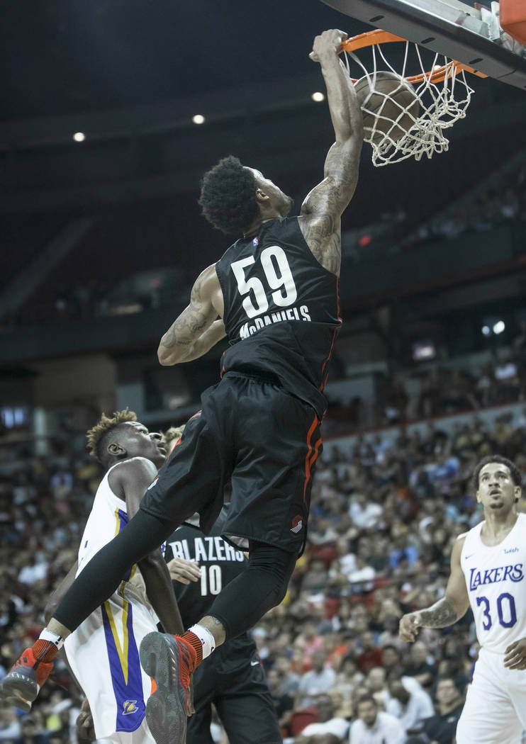 Portland Trail Blazers guard K.J. McDaniels (59) dunks over Los Angeles Lakers guard Isaac Bonga (17) in the fourth quarter during the NBA Summer League finals on Tuesday, July 17, 2018, at the Th ...