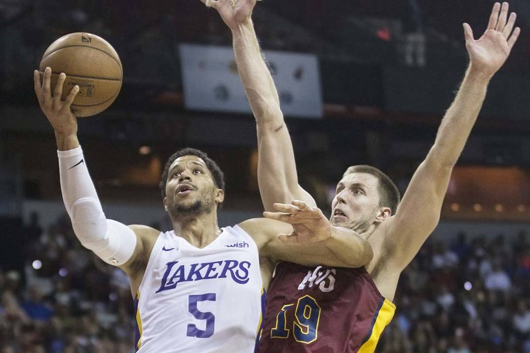 Los Angeles Lakers guard Josh Hart (5) drives past Cleveland Cavaliers forward Vladimir Brodziansky (19) in overtime during the NBA Summer League semifinals on Monday, July 16, 2018, at the Thomas ...