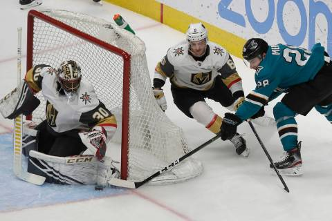 Vegas Golden Knights goaltender Malcolm Subban, left, defends a shot attempt by San Jose Sharks right wing Timo Meier, right, during the third period of an NHL hockey game in San Jose, Calif., Mon ...
