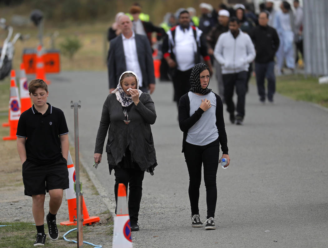 Mourners leave the cemetery after the burial service of a victim of the Friday March 15 mosque shootings at the Memorial Park Cemetery in Christchurch, New Zealand, Thursday, March 21, 2019. (AP P ...