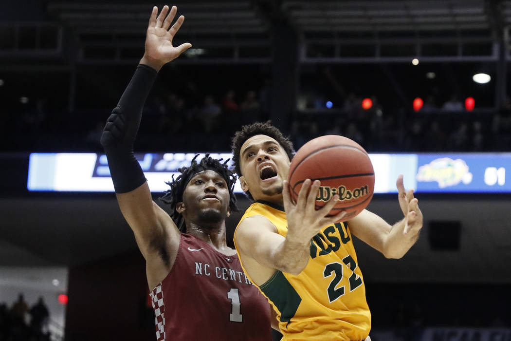 North Dakota State's Cameron Hunter (22) shoots against North Carolina Central's Zacarry Douglas (1) during the second half of a First Four game of the NCAA men's college basketball tournament Wed ...