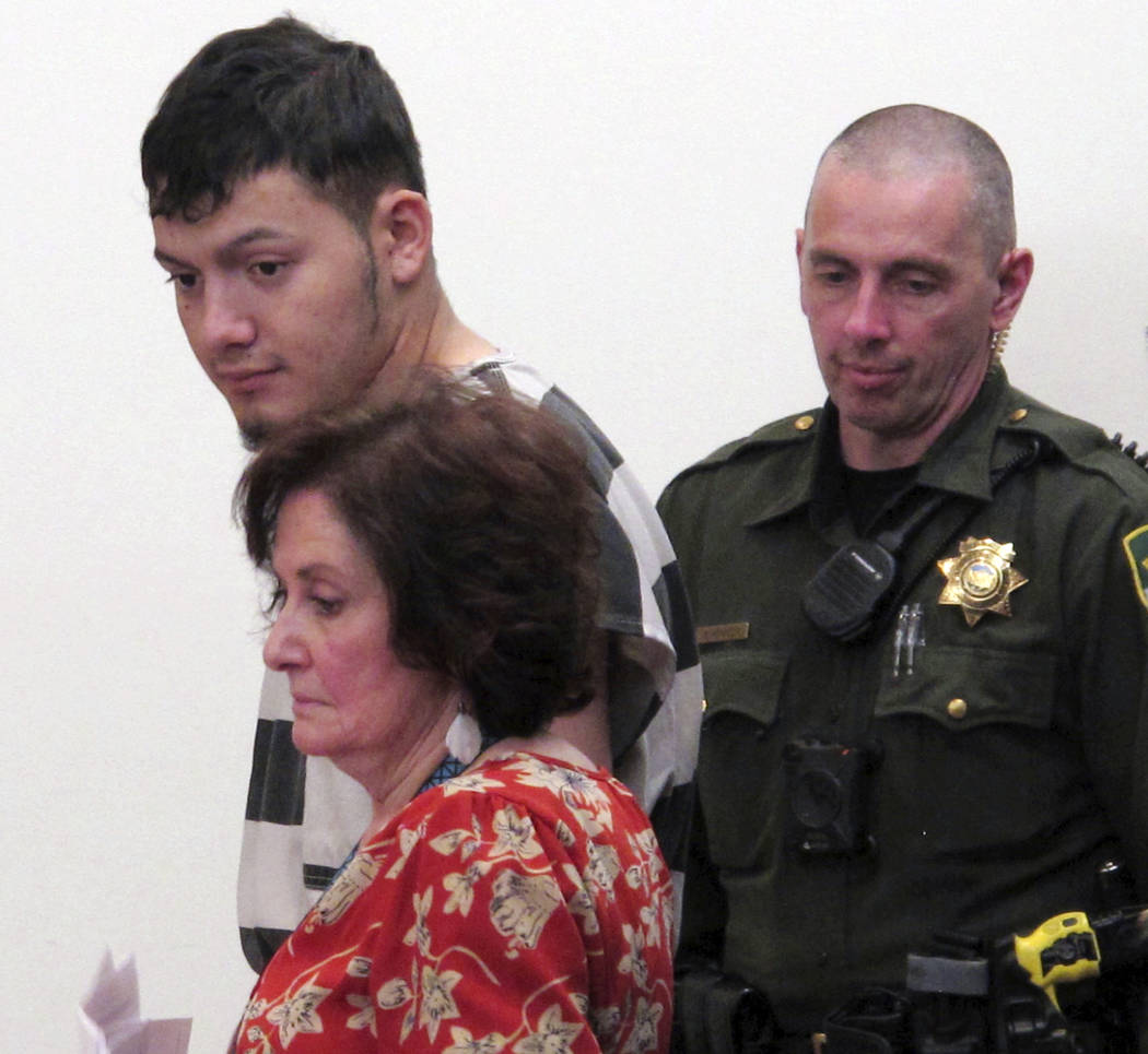 Wilber Ernesto Martinez-Guzman, 19, top left, of El Salvador, listens to proceedings during his initial appearance in Carson City Justice Court, Thursday, Jan. 24, 2019, in Carson City, Nev. Marti ...