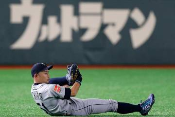 Seattle Mariners right fielder Ichiro Suzuki stretches on the field prior to Game 2 of the Major League baseball opening series between the Mariners and the Oakland Athletics at Tokyo Dome in Toky ...