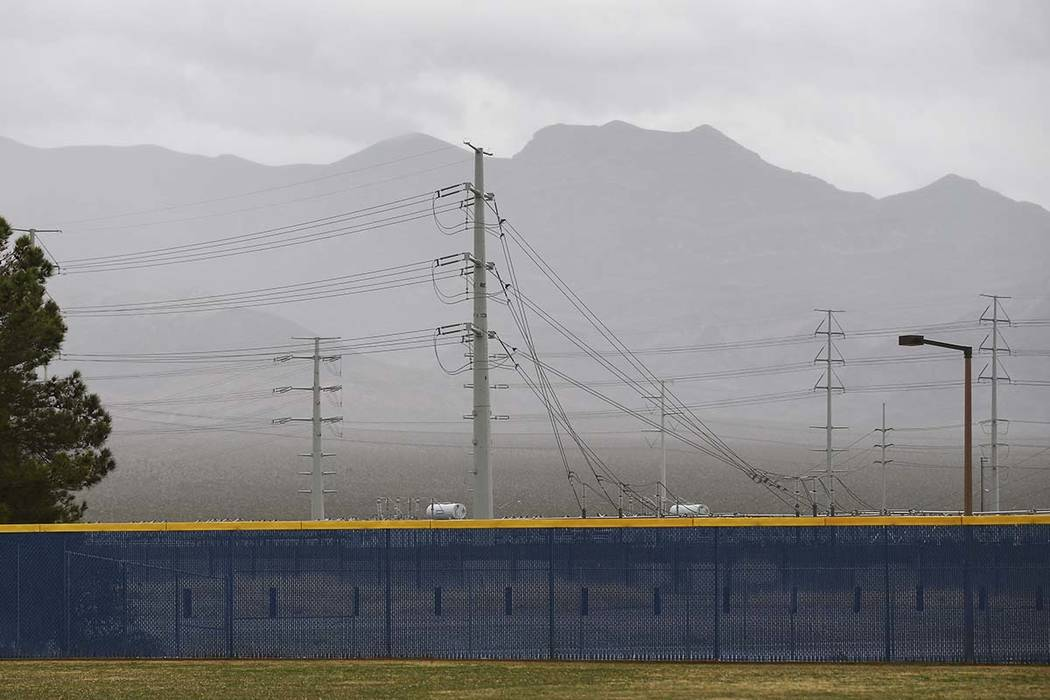 Clouds cover part of the valley as rain comes down at Shadow Ridge High School in Las Vegas on Wednesday, March 20, 2019. (Chase Stevens/Las Vegas Review-Journal) @csstevensphoto