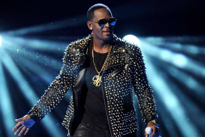 In this June 30, 2013 file photo, R. Kelly performs at the BET Awards in Los Angeles. Kelly has asked the Chicago judge to let him travel overseas for concerts in Dubai, saying he's been unable ...