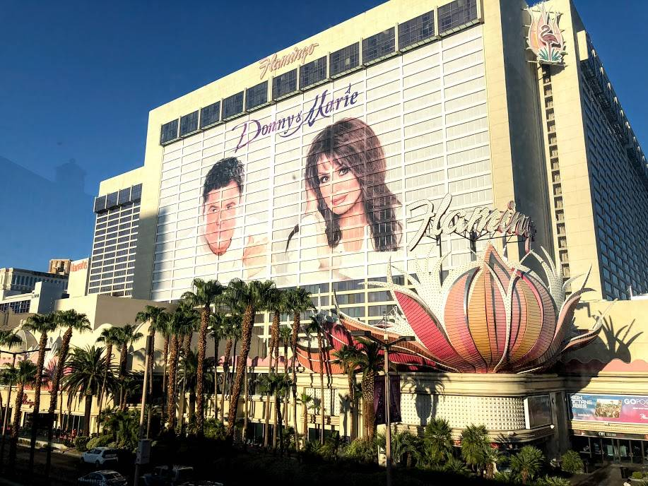 The faces of Donny and Marie Osmond adorn the side of the Flamingo Las Vegas on the Las Vegas Strip, site of their long-running show.