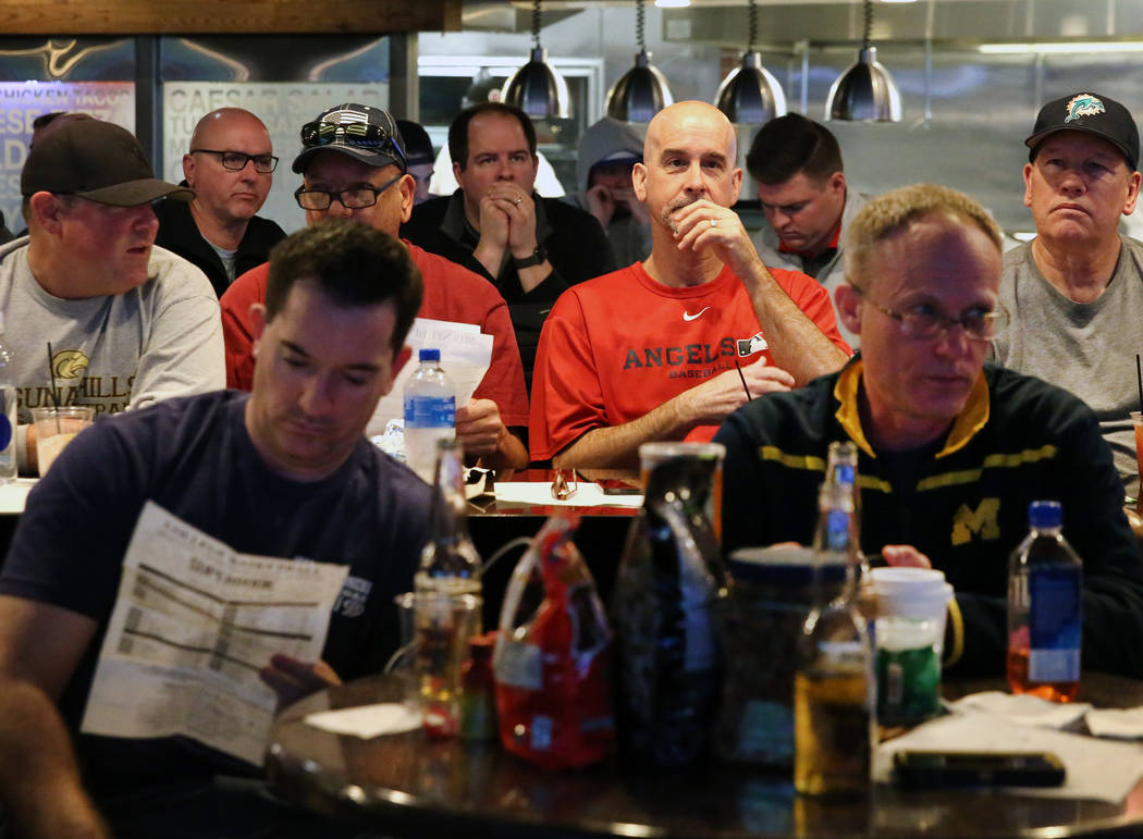 Fans watch a basketball game during the first day of the NCAA basketball tournament at the Westgate sports book in Las Vegas on Thursday, March 16, 2019. (Bizuayehu Tesfaye Las Vegas Review-Journa ...