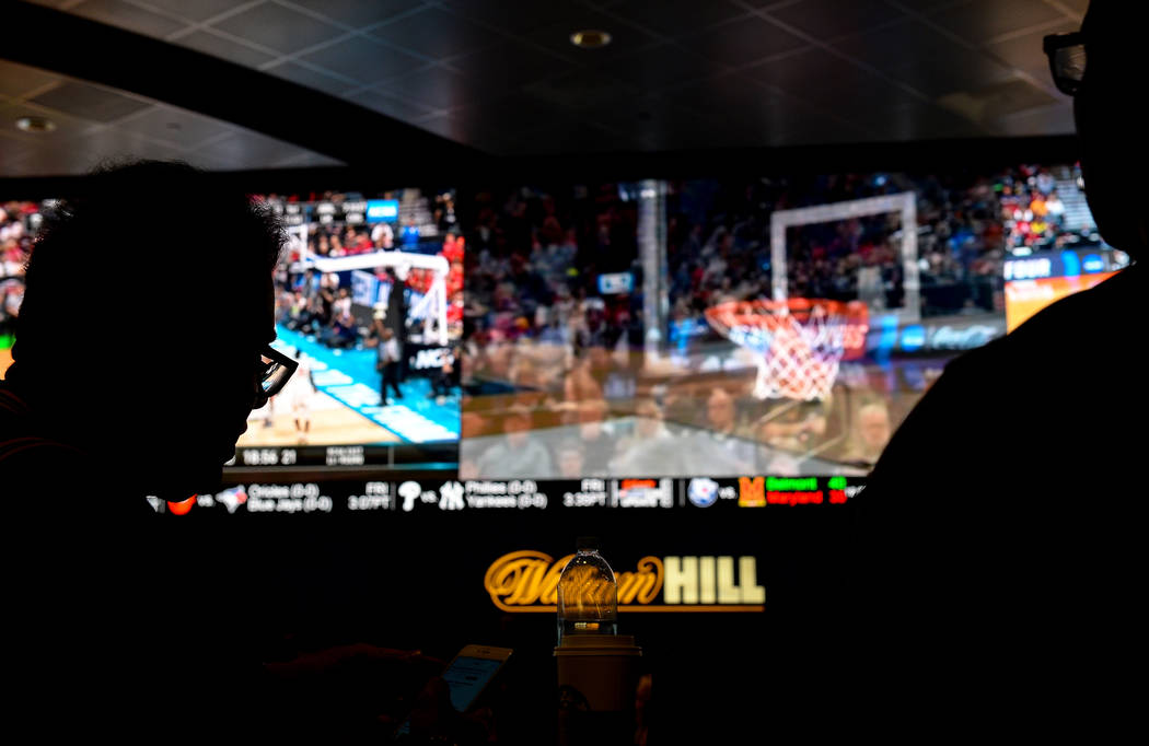 Fans watch the first round of the NCAA men's college basketball tournament at the newly opened sportsbook inside The Strat in Las Vegas, Thursday, March 21, 2019. (Caroline Brehman/Las Vegas Revie ...