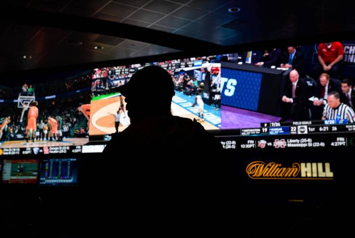 A fan watches the first round of the NCAA men's college basketball tournament at the newly opened sportsbook inside The Strat in Las Vegas, Thursday, March 21, 2019. (Caroline Brehman/Las Vegas Re ...