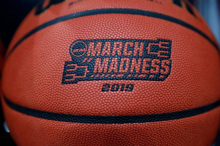A basketball with a logo is seen before a first round men's college basketball game between Minnesota and Louisville in the NCAA Tournament, Thursday, March 21, 2019, in Des Moines, Iowa. (AP Phot ...
