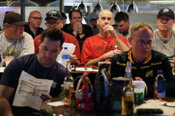 Fans watch a basketball game during the first day of the NCAA basketball tournament at the Westgate sports book in Las Vegas on Thursday, March 21, 2019. (Bizuayehu Tesfaye Las Vegas Review-Journa ...