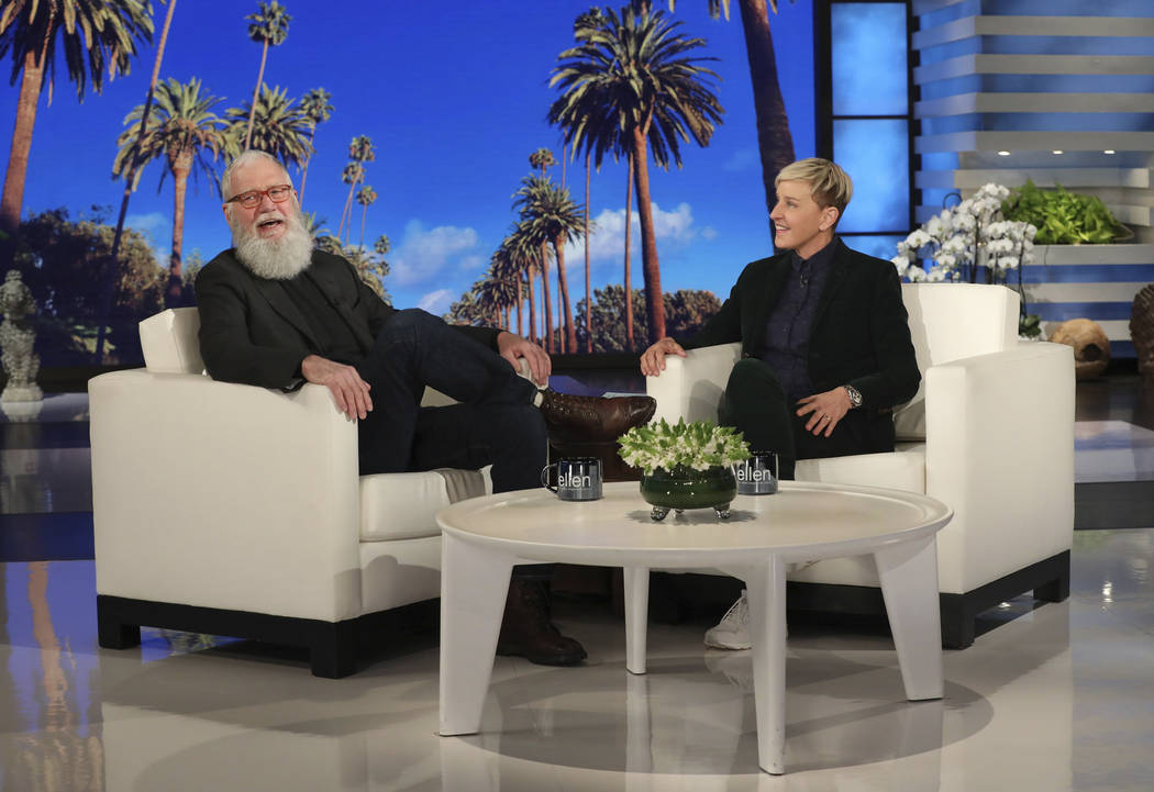 """In this March 7, 2019 photo released by Warner Bros., David Letterman appears with host Ellen DeGeneres during a taping of """"The Ellen DeGeneres Show"""" in Los Angeles. Letterman said he stuck around ..."""
