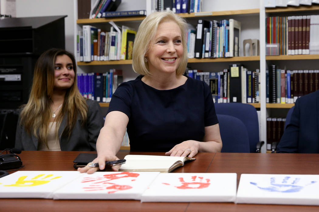 Democratic presidential candidate Sen. Kirsten Gillibrand, D-N.Y., during a roundtable discussion at the UNLV Immigration Clinic, including law student Bryanna Gutierrez, left, and Immigration Cli ...