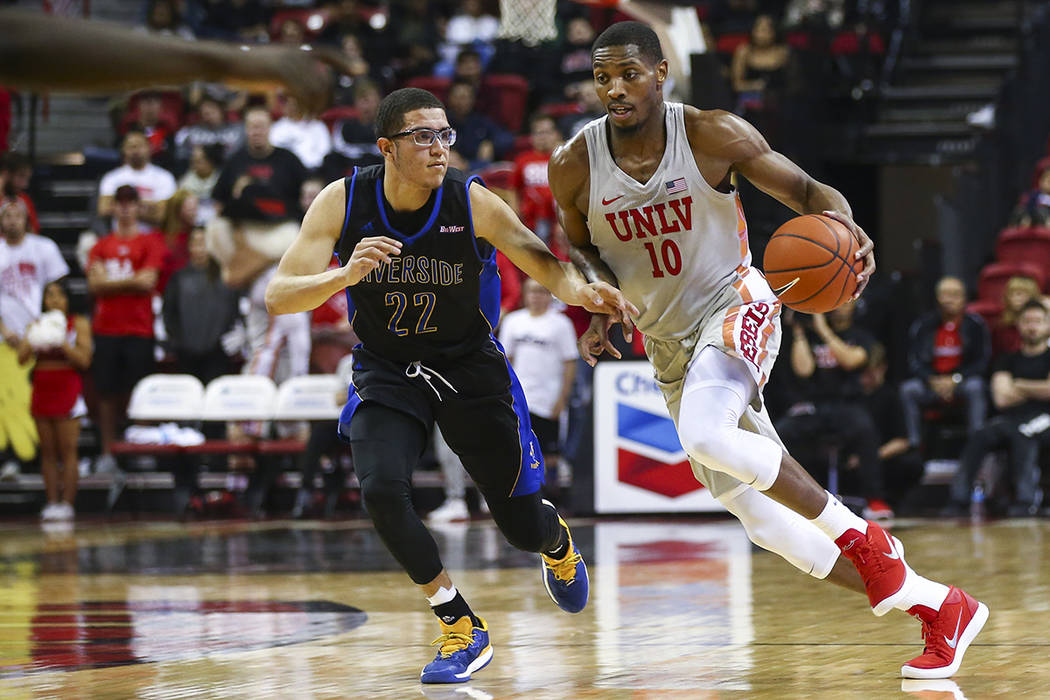 UNLV Rebels forward Shakur Juiston (10) brings the ball up court against UC Riverside Highlanders guard Dominick Pickett (22) during the first half of a basketball game at the Thomas & Mack Ce ...