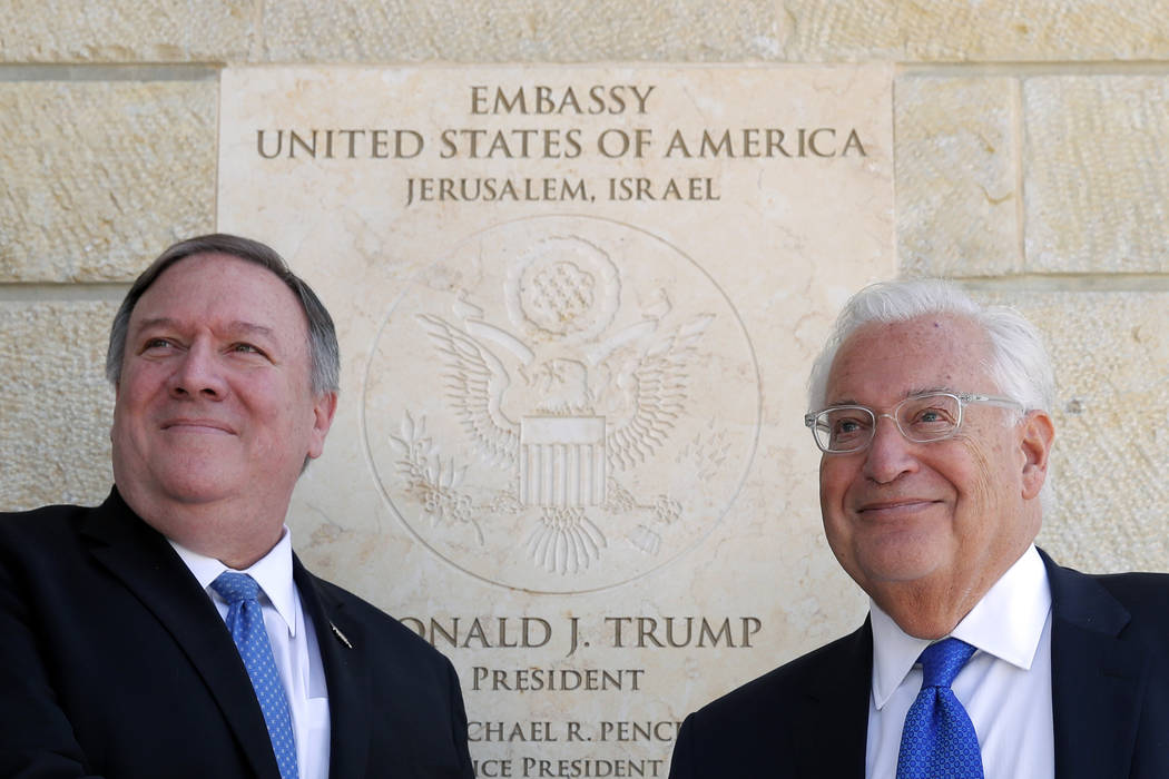 U.S. Secretary of State Mike Pompeo and U.S. Ambassador to Israel David Friedman stand next to the dedication plaque at the U.S. embassy in Jerusalem, Thursday, March 21, 2019. (Jim Young/Pool Ima ...