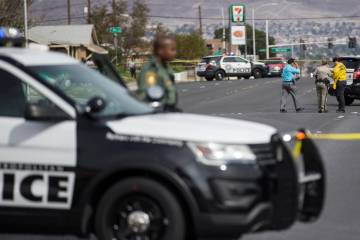 Metro works the scene of an officer-involved shooting in the 500 block of N. 9th Street on Tuesday, March 19, 2019, in Las Vegas. (Benjamin Hager Review-Journal) @BenjaminHphoto